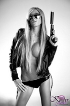 Kimber has a gun bampw Super hot Kimber James posing with a gun in black & white.