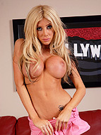 Vegas suite. Busty shemale goddess Kimber James stripping